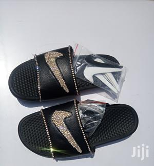 online retailer 254c4 4cc12 DLY Nike Slippers