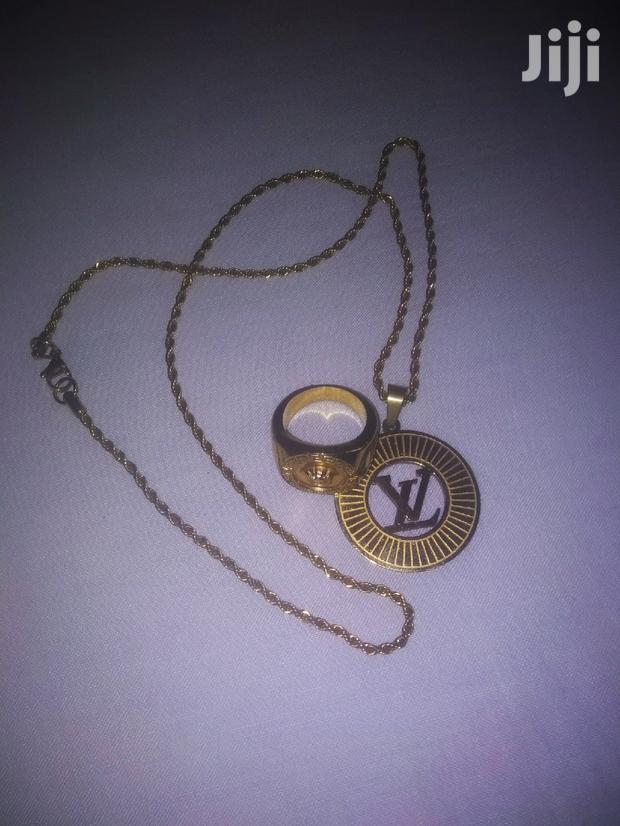 Archive: Louise Vuitton Chain And Versace Ring