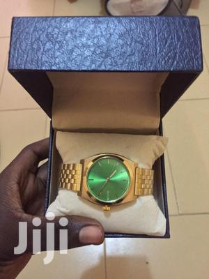 Original Gold Nixon Time Teller With a Green Dial