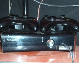 Slightly Used Xbox 360 Slim With Two Cordless Controllers in Condition